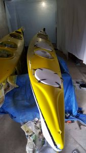 Repaint a kayak after it has been sprayed