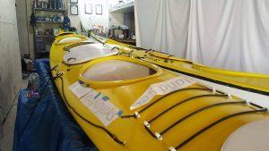 Repaint a kayak, laying down new branding