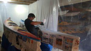 repainting a kayak with a spray gun