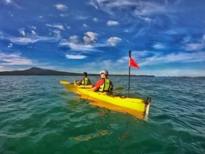Sunset sea kayak tour to Rangitoto with two people in double sea kayak