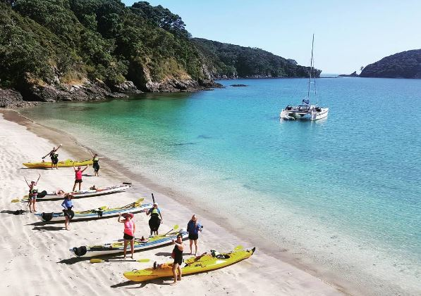 Hauraki gulf kayaking on sandy beach