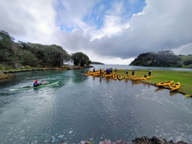 Auckland Sea Kayaks Taking a break on the sunny side of Gardiner's Gap Rangitoto island and Motutapu island